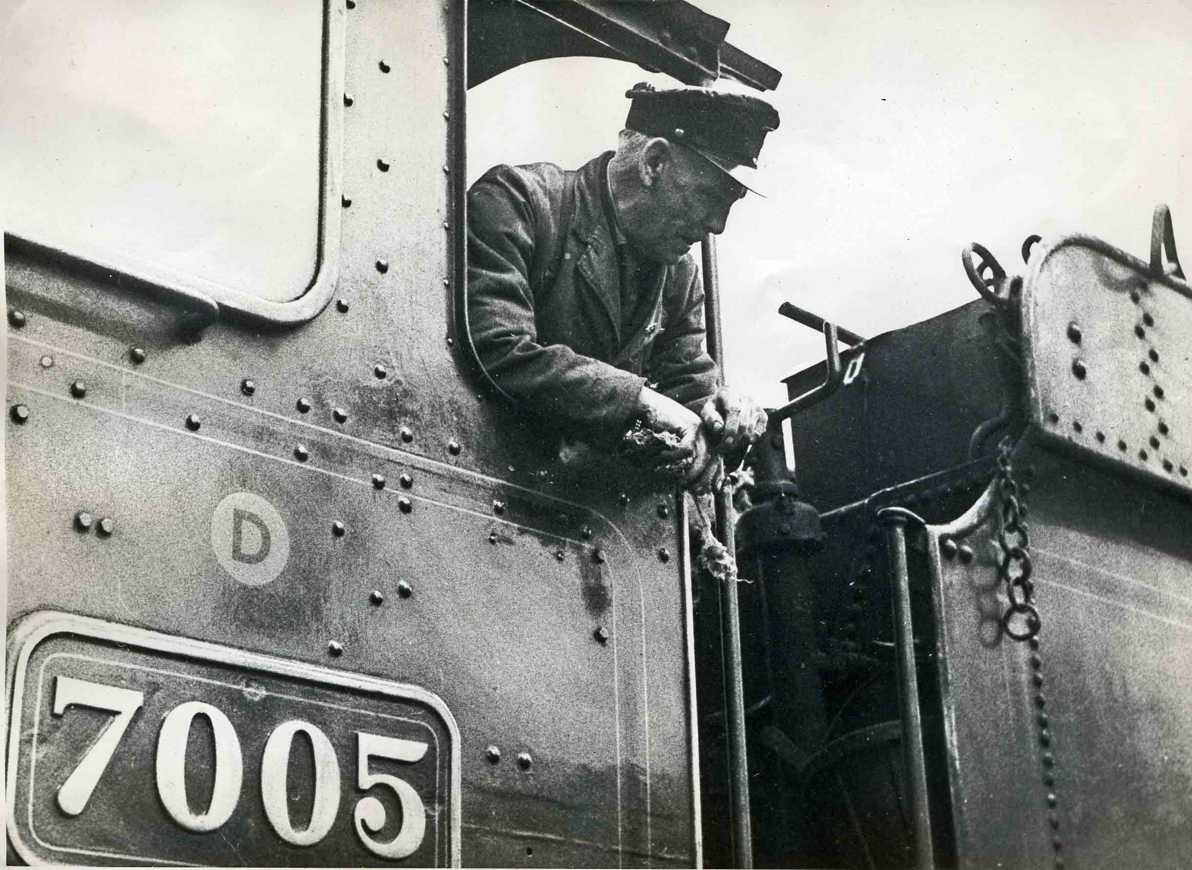 Ted Crocker on the footplate of No.7005